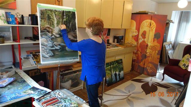 Artist Sandra Cattermole working in her studio
